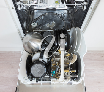 Open dishwasher with clean plates, cups and dishes - Selective focus