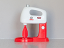 Toy cooking mixer or blender, isolated in the kitchen
