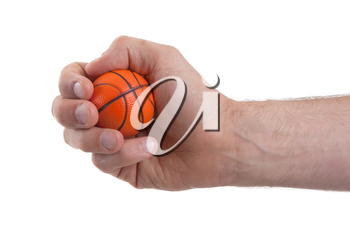 Isolated hand with a mini basket ball on a white background