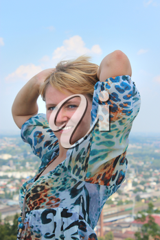 blue-eyed sympathetic girl on the background of view of city