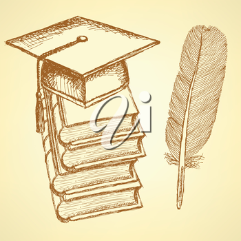 Sketch books with graduation cap on the top and feather pen