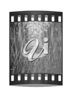 Gold bell on winter or Christmas style background with a wave of stars. The film strip