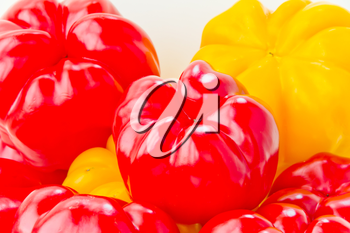 Photo of red and yellow raw pepper on white background