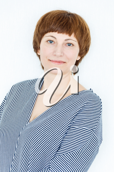 Portrait of happy woman with short brown hair near white wall