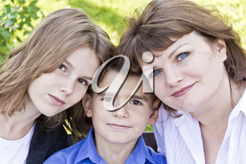 Portrait of happiest mother with daughter and son in summer time