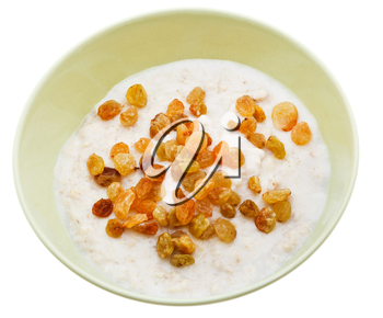 traditional english oat porridge with raisins in yellow bowl isolated on white background