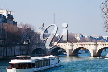 view of Pont Neuf with Eiffel Tower and French Academy on background in Paris