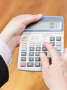above view of calculator in businessman hands