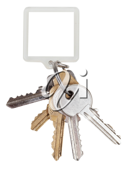bunch of door keys on ring and square keychain isolated on white background