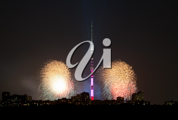 Night view of Moscow city with Ostankino TV Tower and fireworks