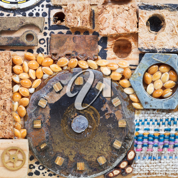 abstract still life from wooden and mechanical objects close up glued to wooden board