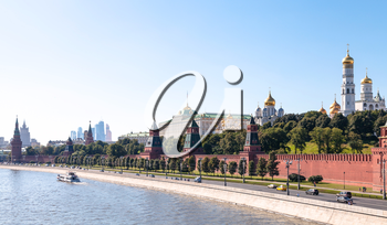 Moscow skyline - panoramic view of The Kremlin embankment, Kremlin buildings, walls, towers, Moscow City in summer afternoon