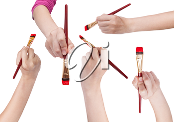 set of hands with flat art paintbrushes with red painted tips isolated on white background