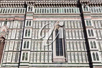 travel to Italy - view of ornamental wall of Florence Duomo Cathedral (Cattedrale Santa Maria del Fiore, Duomo di Firenze, Cathedral of Saint Mary of the Flowers) from Piazza del Duomo in Florence