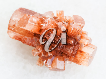 macro shooting of natural mineral rock specimen - crystal of Aragonite gemstone on white marble background from Tazouta, Morocco