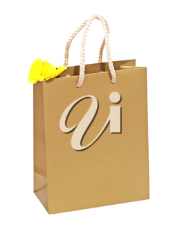 Birthday gift bag with yellow flower isolated on a white background.