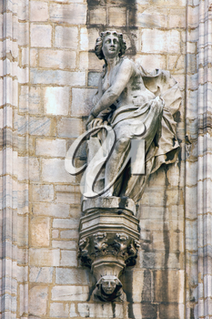 in milan italy statue of a women in the front of the duomo  church  and incision