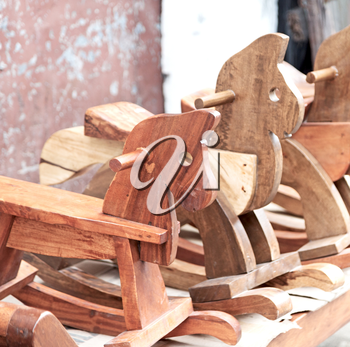 in a old market rocking horse made in wood like abstract concept