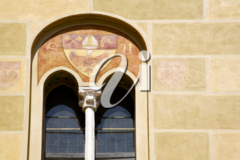 tradate varese italy abstract  window monument curch mosaic in the yellow