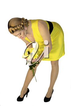 the woman in a yellow dress and with yellow flowers