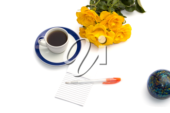 yellow roses, coffee, the globe and handle with a notebook