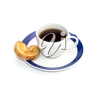 coffee on a saucer with a blue border and one cookies, a subject food and drinks