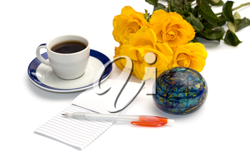 bouquet of yellow roses, coffee, the globe and notebook with the handle, isolate, a still life, a subject flowers and drinks