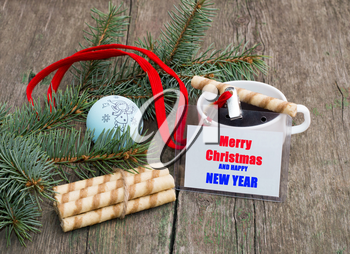 coniferous branch, linking of cookies, coffee and label with an inscription Christmas, a still life the subject Christmas and New Year