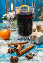 Christmas composition with mulled wine and tangerines