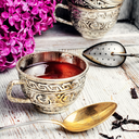 Stylish and fashionable cup of tea and branch of blossoming lilac