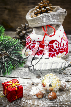 Christmas bag with gifts on the background of Christmas decorations