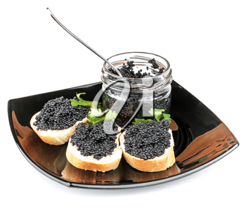Sandwiches with black caviar on plate isolated on white