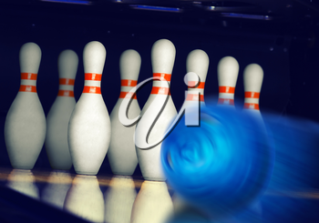 Motion blurred bowling ball on alley