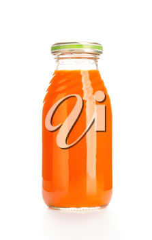 Glass bottle of fruit juice. Isolated over white background.
