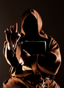 Portrait of mystery preaching monk with wooden rosary and bible