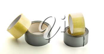 Four rolls of adhesive tape on white background