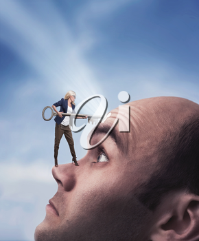 Confident woman with key on the man's face with keyhole