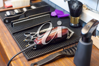 Close up of barber's accessories on the table