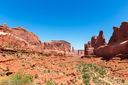 Mountains in valley against blue sky background. Landscape of Arches National Park.