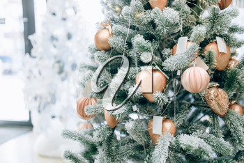 Christmas fir tree decorated with golden toys closeup view, nobody. Xmas holiday celebration symbol, bauble decoration