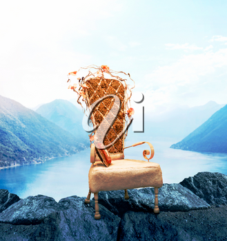 Old chair with grunge upholstery, mountains and lake on background. Classic luxury style. Abstract decoration