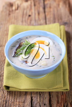 Sour cream dill soup with mushrooms and boiled egg