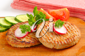 Pan fried patties with sliced vegetables