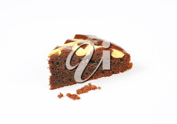 slice of chocolate cake with cream cheese on white background