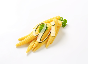 heap of sweet baby corn on white background