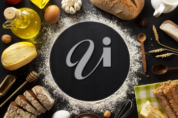 bread and bakery  ingredients on wooden background