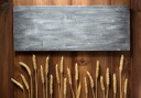 wheat grains on wooden plank background