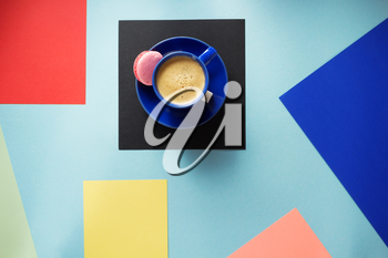 cup of coffee at colorful paper background