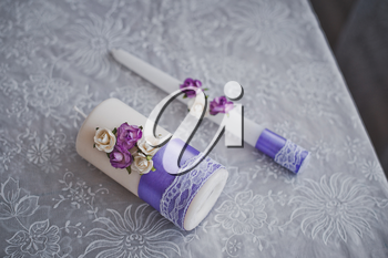 Candles with champagne decorated with a pattern from flowers.