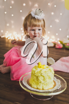 Little Princess eating her first cake.